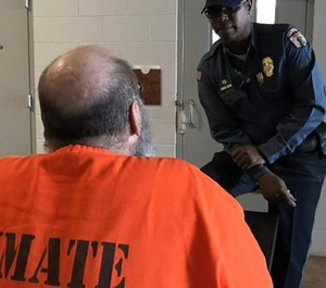 A corrections officer talks with an inmate at the Joseph Harp Correctional Center in Lexington. (Photo/ODOC)