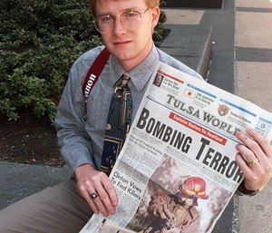Freelance photograpaher and bank clerk Charles H. Porter IV shows off a copy of the Tulsa World Thursday, April 20, 1995, in Oklahoma City, that displays his photograph on the front page of a fireman with a baby victim from the Oklahoma City car bomb blast. (AP Photo/David Longstreath)
