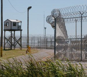 This July 10, 2017, file photo shows a tower outside of the razor wire at the Great Plains Correctional Facility in Hinton, Okla. (AP Photo/Sue Ogrocki, File)