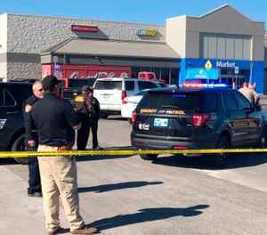 Two victims were shot inside a car and the third was in the parking lot outside a Walmart in Duncan, Okla. (Photo/Sean Murphy/AP)