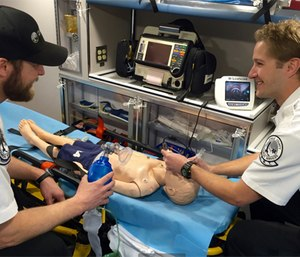 Paramedic Jimmy Vonesh with his EMT partner Dane Swanson switch roles for this in-service. (Photo by Will Dunn)