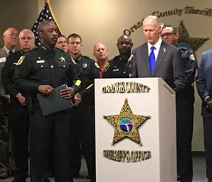 Central Florida law enforcement leaders joined Gov. Rick Scott for a signing of House Bill 477. (Photo/Orlando Police)