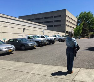 Terry Carlisle looks at the Douglas County Jail in Roseburg, Ore., where she was incarcerated under what she describes as horrific conditions in 2015 for drunken driving.