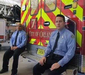 In this Thursday, June 30, 2016 photo, the first paramedic-firefighters to respond to the Pulse nightclub shooting stand by their emergency vehicle at their fire station in Orlando, Fla. (AP Image)