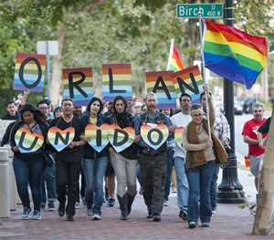 Several hundred supporters marched after a vigil in support of the Orlando shooting victims Sunday, June 12, 2016, in Santa Ana, Calif.