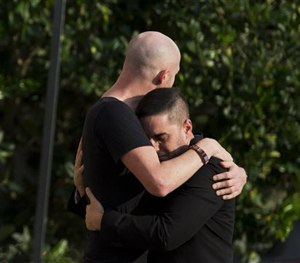 Mourners embrace outside the visitation for Pulse nightclub shooting victim Javier Jorge-Reyes on Wednesday, June 15, 2016, in Orlando, Fla. (AP Image)
