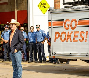 Kyle Wray, interim senior vice president for executive affairs, speaks at the unveiling ceremony of a new ladder truck for Stillwater Fire Department with Oklahoma State University branding.