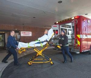 Richard Young (left), firefighter/AEMT with Norfolk Fire-Rescue, and Heather Joyner, firefighter/paramedic with Norfolk Fire-Rescue, deliver a patient to Bon Secours DePaul Medical Center in Norfolk, Va. (Photo/Richard Muldez, Bon Secours Hampton Roads Health System)