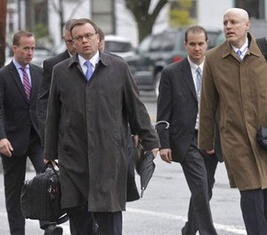 Pike County District Attorney Ray Tonkin, front center, arrives for the first day of the trial of Eric Frein, an anti-government survivalist accused of killing a Pennsylvania police trooper and injuring a second in a 2014 ambush at their barracks, on Tuesday, April 4, 2017, at the Pike County Courthouse in Milford, Pa.