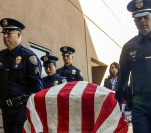 "Palm Springs police officers carry the casket of officer Jose ""Gil"" Vegaat Palm Springs Convention Center on Oct. 18. (Photo/Los Angeles Times)"