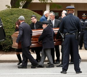 Pittsburgh police stand guard as pallbearers carry the casket of Irving Younger, 69, from Congregation Rodef Shalom after his funeral on Wednesday, Oct. 31, 2018, in Pittsburgh. Younger was one of the eleven victims killed in the deadly shooting at a synagogue in Pittsburgh's Squirrel Hill neighborhood on Saturday. (AP Photo/Keith Srakocic)
