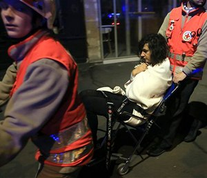 A woman is evacuated from the Bataclan theater after a shooting in Paris. (AP Photo/Thibault Camus, File)