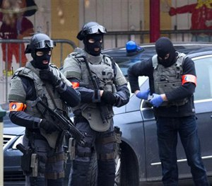 Special operations police secure an area during a police raid in the Molenbeek neighbourhood of Brussels, Belgium.