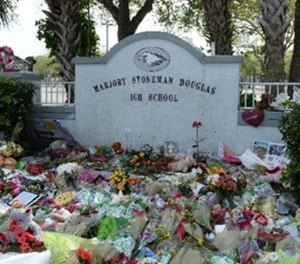 Students visit memorial for Stoneman Douglas High School Shooting victims on February 23, 2018 in Parkland, Florida. (Photo/mpi04/MediaPunch/IPX)