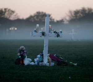 An early morning fog rises where 17 memorial crosses were placed, for the 17 deceased students and faculty from the Wednesday shooting at Marjory Stoneman Douglas High School, in Parkland, Fla., Saturday, Feb. 17, 2018.