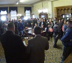 Union and community members crowd into a City Hall room in Milwaukee on Thursday, Oct. 16, 2014 during a news conference to protest the firing of a Milwaukee police officer in connection to the fatal shooting of a mentally ill man in a downtown park.