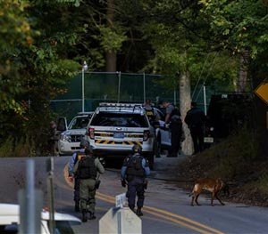 In this Monday, Sept. 22, 2014 photo, law enforcement personnel continue their search for Eric Frein, the suspect in the ambush at the Pennsylvania State Police barracks in Blooming Grove, in Monroe County, Pa. Frein is accused of killing Cpl. Bryon Dickson, 38, and critically wounding Trooper Alex Douglass outside the remote post in the Pocono Mountains on Sept. 12.