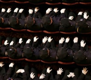 New police officers attend their graduation ceremony at the Beacon Theatre in New York, Thursday, Dec. 28, 2017. (AP Photo/Seth Wenig)