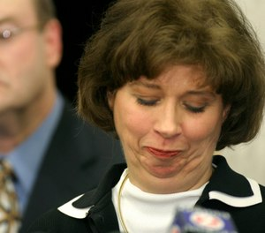 Wisconsin Attorney General Peg Lautenschlager reacts as she makes a statement to the media Thursday, Feb. 26, 2004, in Madison, Wis, about charges of operating a vehicle while intoxicated. (AP Photo/Andy Manis)