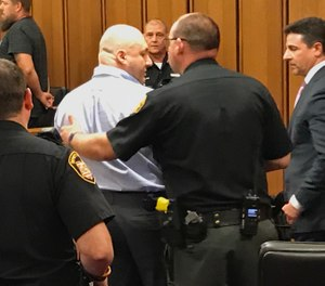 Cuyahoga County sheriff's deputies place handcuffs on Thomas Knuff Jr. after a jury recommended he receive the death penalty for the murders of John Mann and Regina Capobianco. (Photo/Cory Shaffer, cleveland.com)