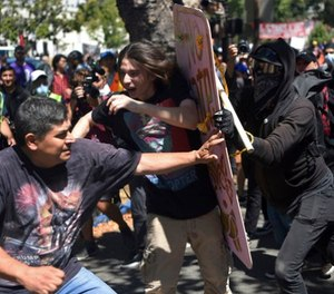 In this Aug. 27, 2017 file photo, demonstrators clash during a free speech rally in Berkeley, Calif. (AP Photo/Josh Edelson, File)