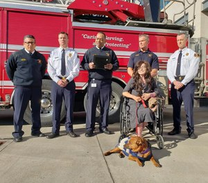 Dallas Firefighter Peter Hartnett (standing second from right) was recognized at a ceremony Monday for his lifesaving actions after Danyeil Townzen was set on fire by her ex-boyfriend. (Photo/Dallas Fire-Rescue Facebook)