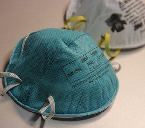 Two California EMTs have sued their former employer claiming they were wrongfully terminated for objecting to transporting COVID-19 patients without properly-fitted N95 masks. (Photo/CDC)