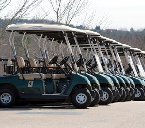 Officials say a man who was riding in the back of a golf cart was hit by an ambulance after jumping out of the cart trying to avoid the oncoming rig.