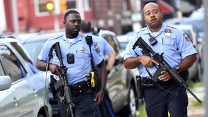 Police officers wearing body cameras respond to a shooting in Philadelphia in August. Image: Mark Makela/Getty Images