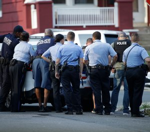 Police stage as they respond to an active shooting situation, Wednesday, Aug. 14, 2019.