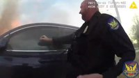 Video: Ariz. cops rescue man trapped in burning car