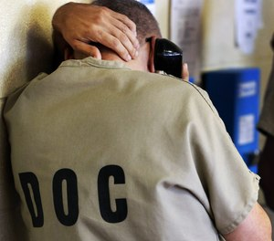 An inmate uses a phone at the Cook County Jail in Chicago