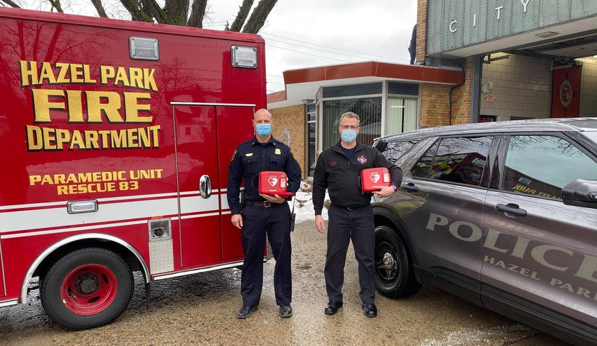 Hazel Park Police Chief Brian Bucholz and Fire Chief Richard Story pose with AEDs.