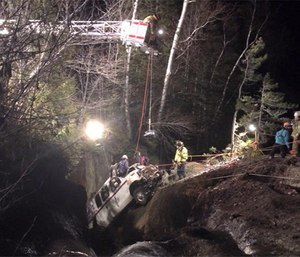 Crews extricating the vehicle from the river. (Photo courtesy Rangeley Fire Department Facebook page)