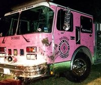 Pink fire truck overturns en route to breast cancer event