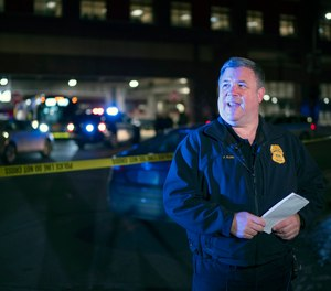 Minneapolis Police Public Information Officer John Elder briefs reporters on the shooting of two people on a bus, Feb. 6, 2020, in Minneapolis.
