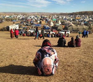 Protesters gather at an encampment on Saturday, Nov. 26, 2016, a day after tribal leaders received a letter from the U.S. Army Corps of Engineers that told them the federal land would be closed to the public on Dec. 5, near Cannon Ball, N.D. (AP photo/James MacPherson)
