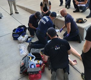 This photo shows AMR and Boulder Fire-Rescue crews receiving training in pit crew resuscitation. The agencies are adopting the model following its success at the nearby Longmont Fire Department, which has used the method for about five years. (Photo/AMR - Boulder County, City of Boulder and Longmont)