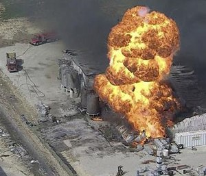 In this image from video by KDFW, a fire burns at the Tri-Chem Industries plan in Cresson, Texas.
