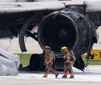 Plane catches fire at Fla. airport; 1 burned, a dozen hurt