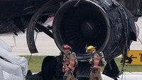 Plane catches fire at Fla. airport; 1 burned, a dozen hurt