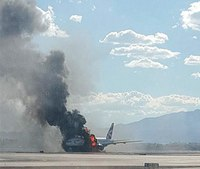 Plane catches fire at Las Vegas airport; 14 injured