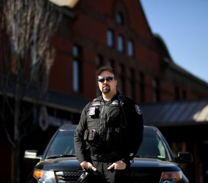 Spokane police Officer Richie Plunkett is risking his health and safety to work with homeless and disadvantaged individuals during the COVID-19 pandemic. (Photo/TNS)