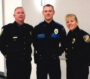 Sergeant Tyler Reddington (center) pictured with his parents. (Photo/Lisa Reddington)