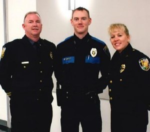 Sergeant Tyler Reddington (center) pictured with his parents.