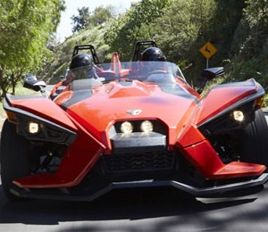 The Slingshot is a topless roadster but is equipped with waterproof seats and lockable storage bins.
