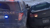 Detroit man crashes into police car, admits driving high