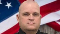 Suspect in Arkansas officer's death faced theft, drug charges