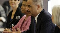 Holder: Use debate on police force to aid relations