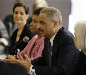 Attorney General Eric Holder speaks during a building community trust roundtable discussion with law enforcement, elected officials and community leaders Thursday, Feb. 5, 2015, in Oakland, Calif.